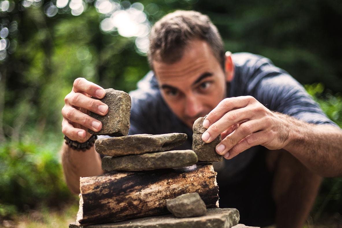 man balancing rocks